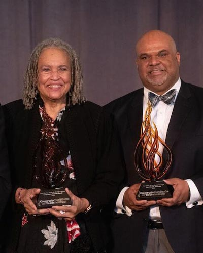 Dr. Hamilton E. Holmes and Charlayne Hunter-Gault holding their awards